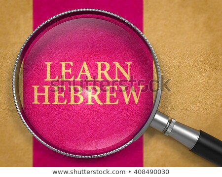 learn hebrew through loupe on old paper stock photo © tashatuvango