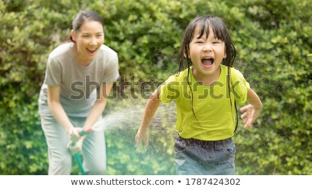 woman playing with hose Stock photo © IS2