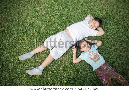 boy lying in grass laughing Stock photo © IS2