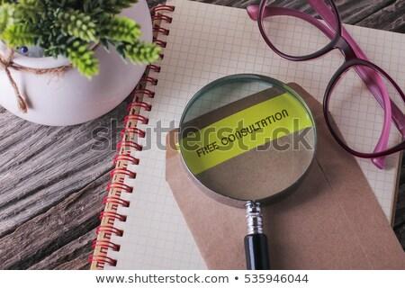 free consultation on file folder blurred image stock photo © tashatuvango