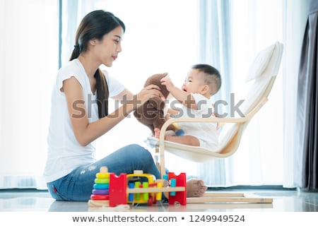 Mother and baby playing with teddy bear Stock photo © IS2