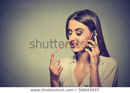 Stock photo: Pretending Woman Hiding Lie