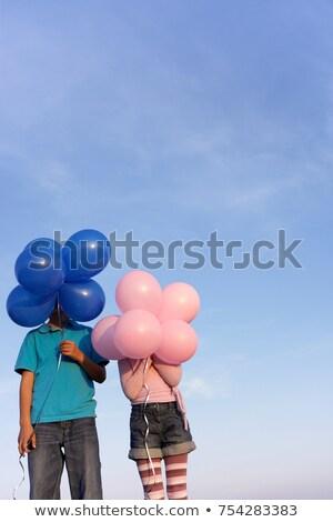 Kettő gyerekek rejtett mögött léggömbök jókedv Stock fotó © IS2