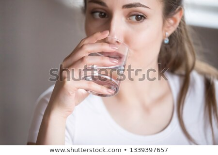 Pills with glass of water Stock photo © IS2