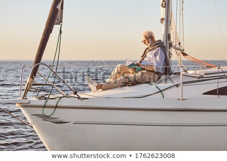 A mature man sitting by the sea Stock photo © IS2