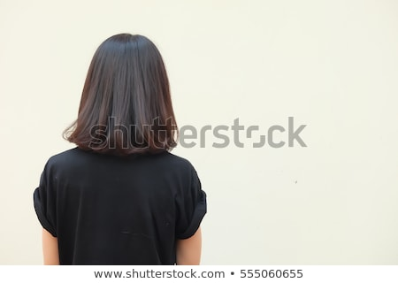 Fashion model with edgy haircut posing in studio Stock photo © epstock