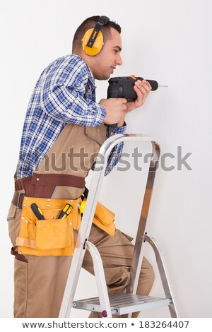 homem · perfuração · buraco · alegre · trabalhando · branco - foto stock © amaviael