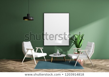 Elegant and minimalistic picture frame standing on blue wall Stock photo © adamr