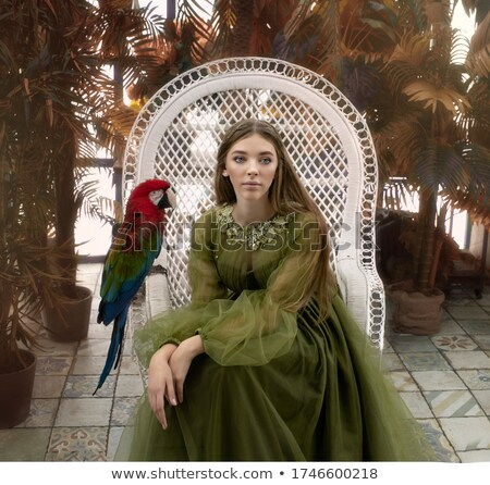 A red hair girl in jungle with parrot Stock photo © bluering