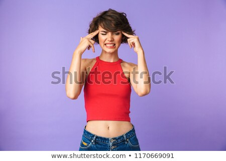 Image of tense displeased woman 20s in casual wear frowning and  Stock photo © deandrobot