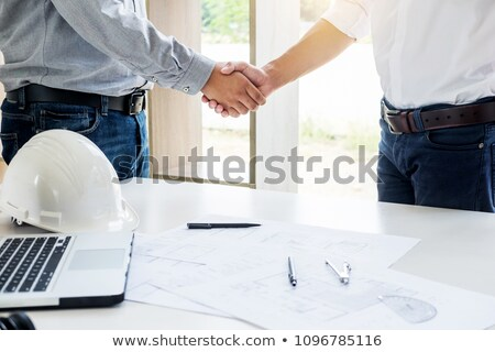 architecture and home renovation concept - builder with blueprin Stock photo © snowing