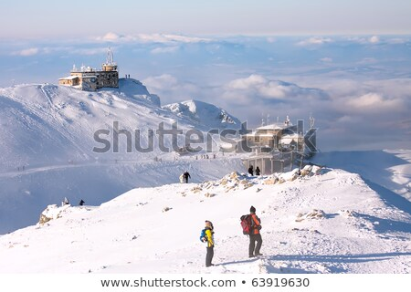 observatory on a mountain peak in the snow stock photo © kotenko