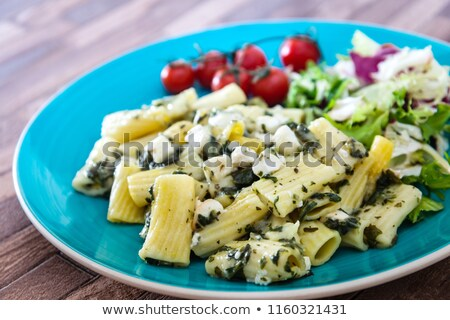 Pasta with spinach pesto and goat cheese Stock photo © boggy