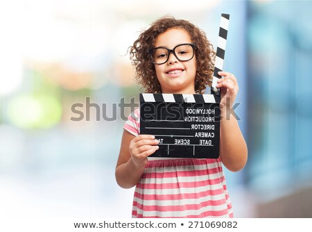 Boy and girl holding clapboard Stock photo © colematt