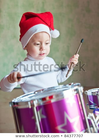 Christmas child playing drum on a white background Stock photo © Imaagio