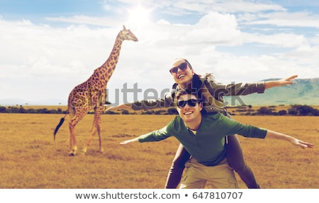 woman with backpack over african savannah Stock photo © dolgachov