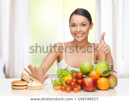 happy woman with fruits at hamburger Stock photo © dolgachov