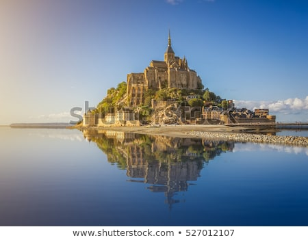 Panoramic view of famous Le Mont Saint Michel with sunset stock photo © doomko