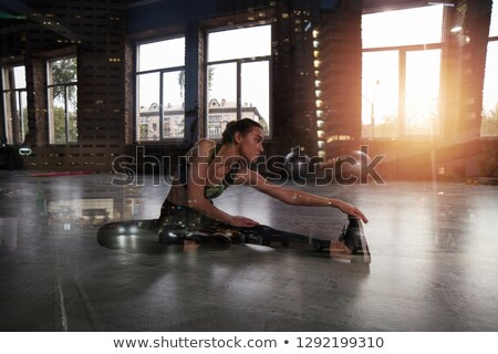 Athletic girl does stretching exercises at the gym. Double exposure Stock photo © alphaspirit