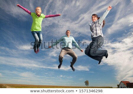 Mother And Daughter Jumping In Mid-air Stock photo © AndreyPopov