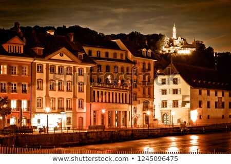 Lucerne Reuss river waterfront evening sepia color view Stock photo © xbrchx
