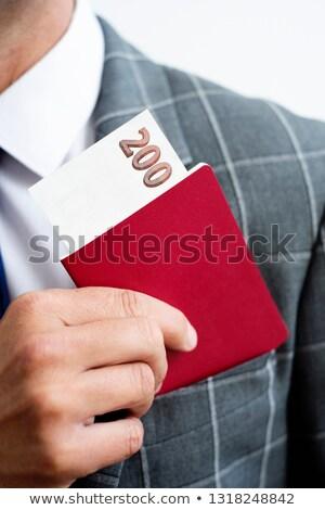 Man honderd bankbiljet paspoort jonge Stockfoto © nito