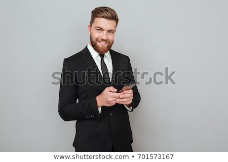 man in suit posing and looking away stock photo © feedough