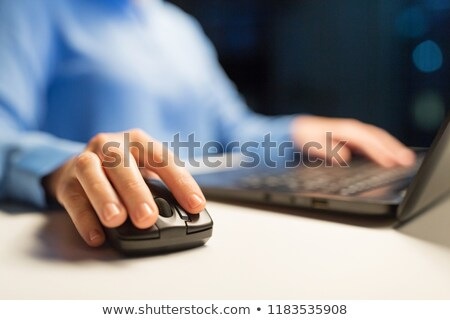 computer mouse on table at night office Stock photo © dolgachov