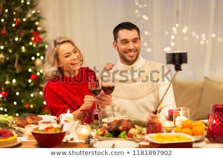 couple with smartphone at home christmas dinner Stock photo © dolgachov