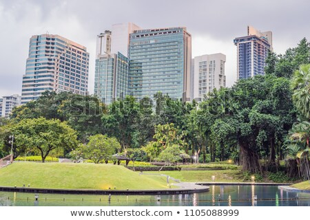 Central Park in Kuala Lumpur against the background of skyscrapers Stock fotó © galitskaya