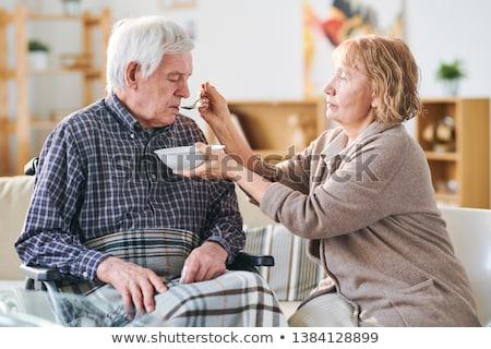 Feeding sick man Stock photo © pressmaster