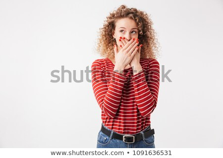 Young mystery blonde curly woman in casual clothes covering mouth Stock photo © deandrobot