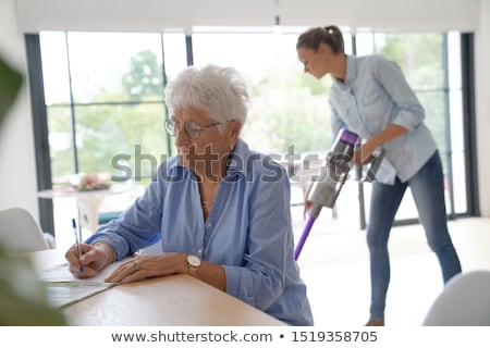 Disabled cleaner doing chores at home Stock photo © Elnur