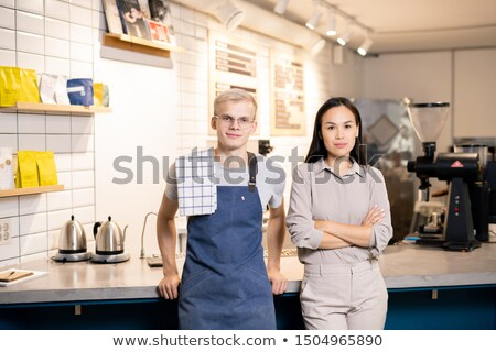 two young workers of contemporary cafe or restaurant standing by workplace stock photo © pressmaster
