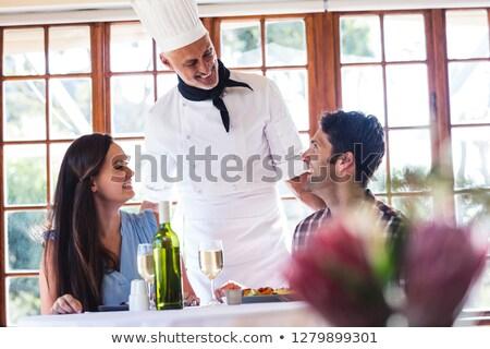 male chef talking to couple at restaurant stock photo © wavebreak_media