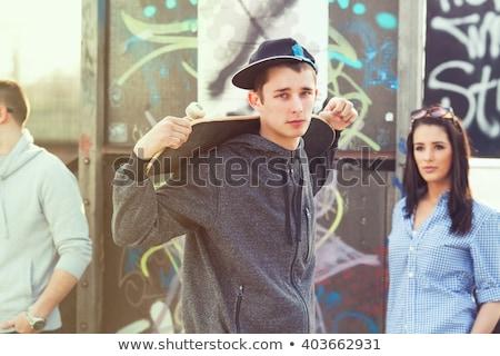 Stockfoto: Tiener · jongen · portret · skateboard · urban · scene · glimlach