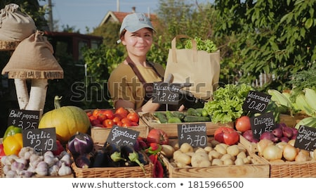 Woman Seller with Vegetables in Boxes Marketplace Stock photo © robuart