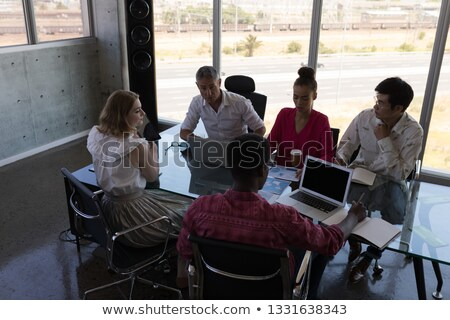 High angle view of diverse business colleagues looking concentrated while working together in modern Stock photo © wavebreak_media