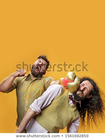Plump guy punching a skinny nerd Stock photo © majdansky