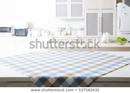 Kitchen table with tablecloth Stock photo © karandaev