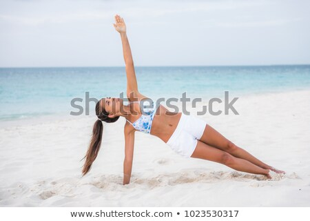Side plank yoga fitness girl training balance strengthening abs muscles and wrist, toning body with  Stock photo © Maridav