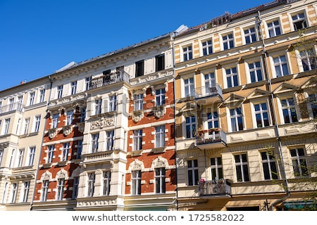 Facades of some renovated old residential construction Stock photo © elxeneize