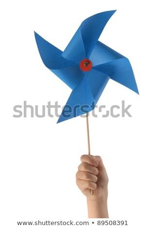 close up of hand holding pinwheel toy Stock photo © dolgachov