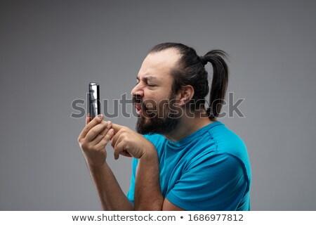 Man grimas aanraken smartphone scherm bebaarde Stockfoto © Giulio_Fornasar