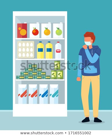 Young couhging man wearing face medical mask cough near shelves with food in supermarket Stock photo © robuart
