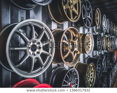 Aleación coche ruedas pared neumáticos tienda Foto stock © smithore