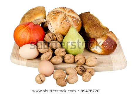 gem, nuts, eggs and a pumpkin on a wooden board Stock photo © gewoldi