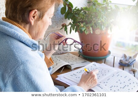 Woman doing the crosswords Stock photo © photography33