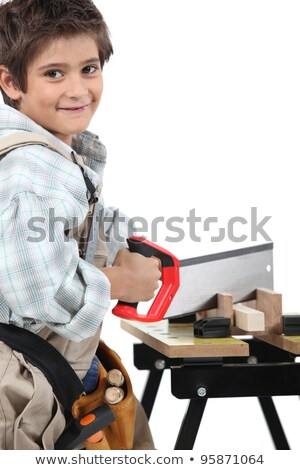 Stock photo: Young child dressed up as a tradesperson
