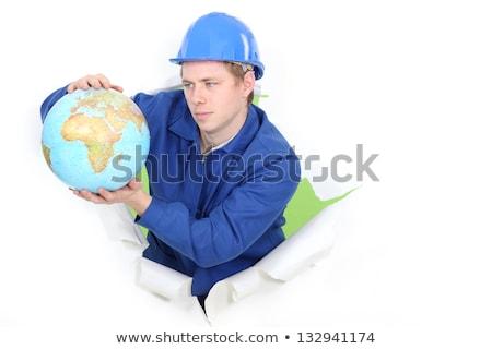 Kereskedő tart földgömb férfi kék munkás Stock fotó © photography33